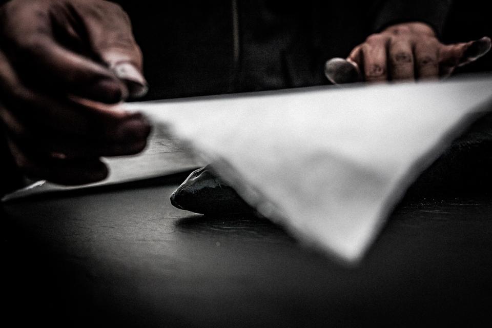 Dwight Hwang creating a gyotaku print.
