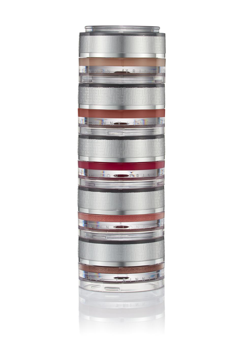 A stack of TRINNY LONDON makeup jars.