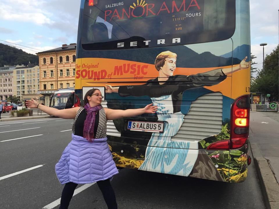 The author imitating Julie Andrews outside The Sound of Music tour bus.