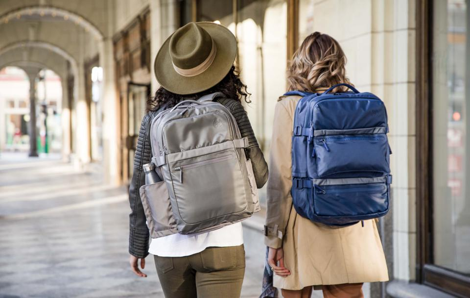 two girls with backpacks