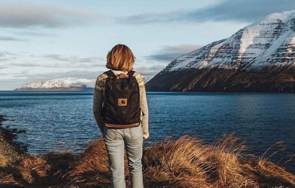 black backpack on female hiker