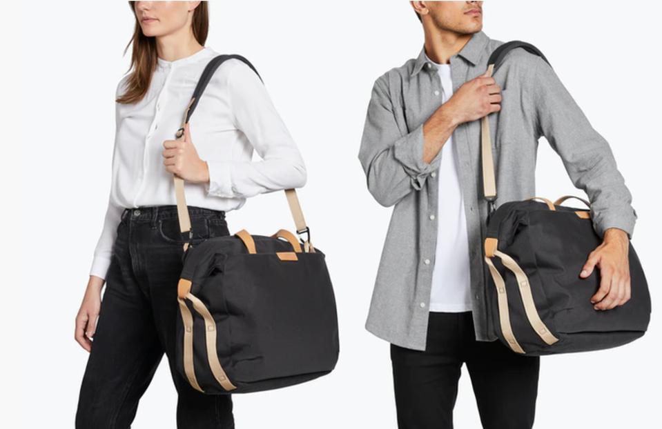 man and woman carrying black weekender duffel