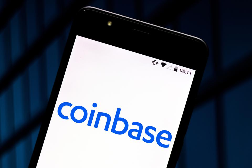 In this photo illustration the Coinbase logo is seen...