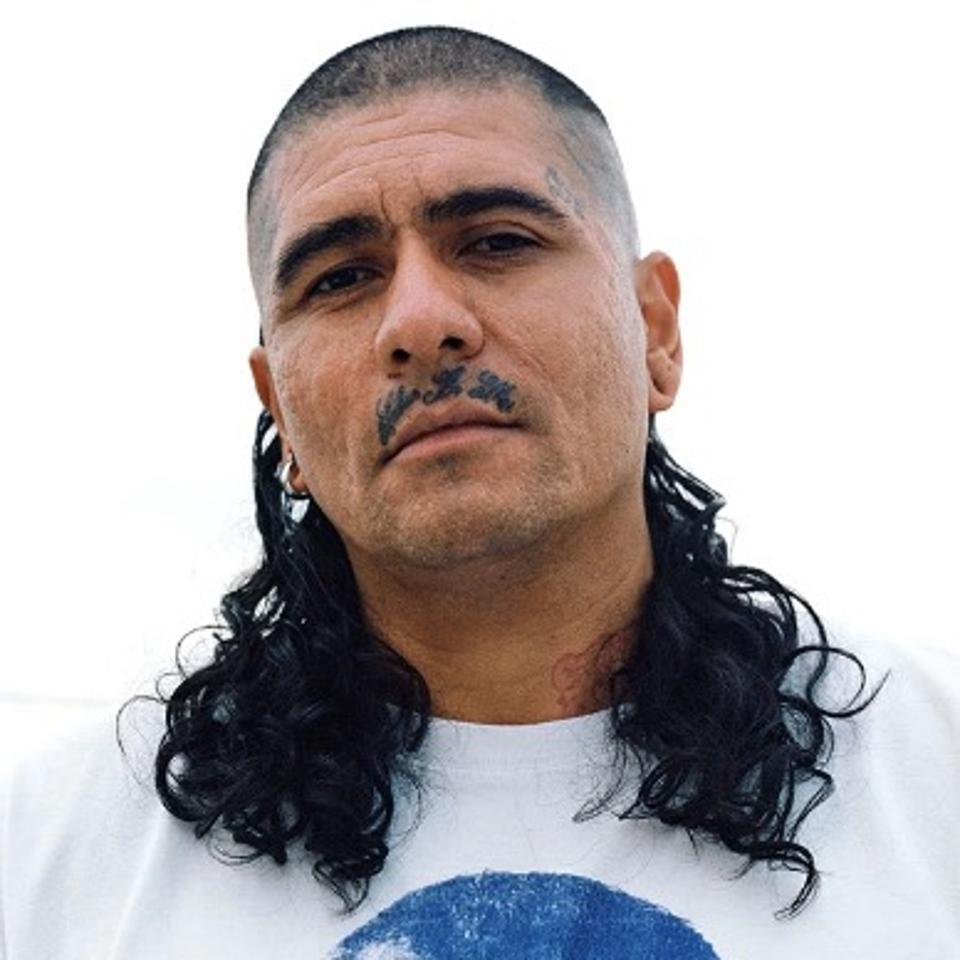 Rafa Esparza, a man with long hair - headshot