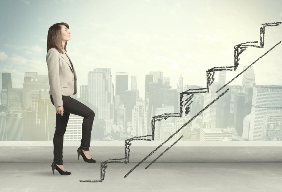 A young, female entrepreneur climbing the metaphorical staircase of innovation.