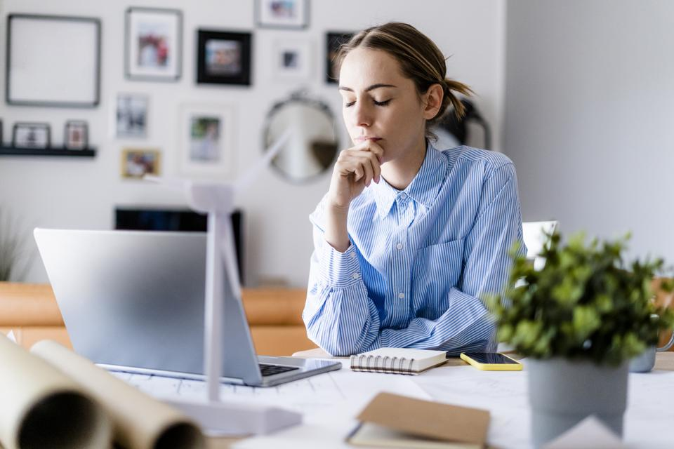 Female professional with worried look -- how to avoid burnout in your job search