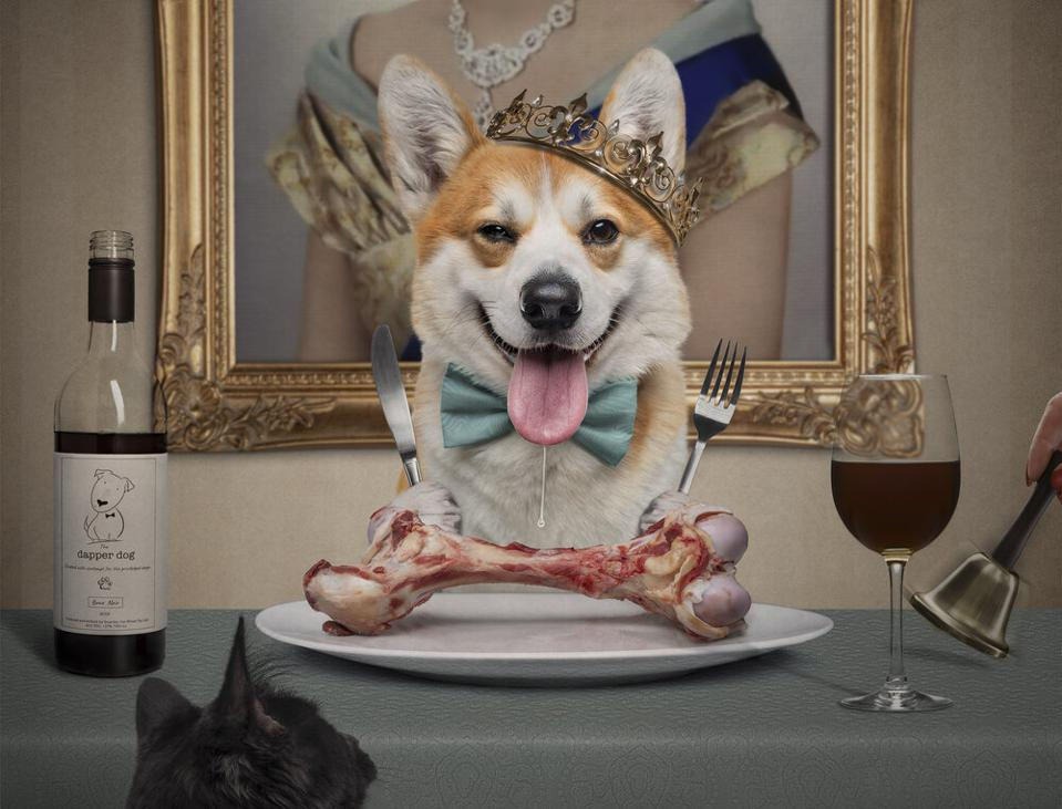 Dog with crown at a table