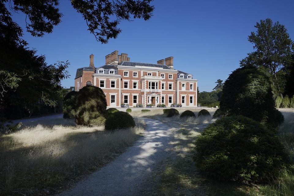 stately brick home and grounds