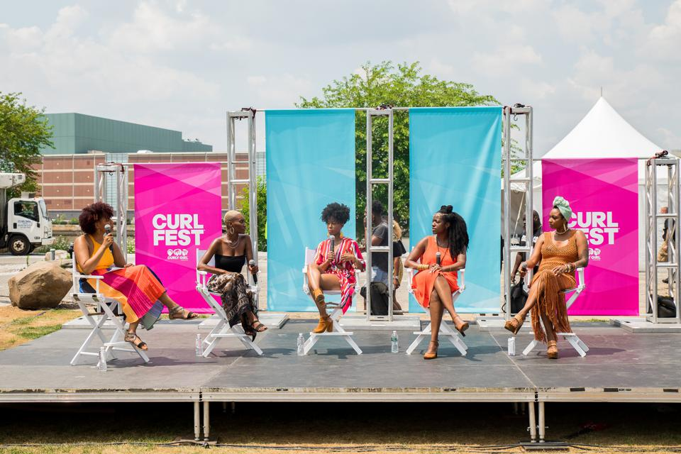 Five ladies having a discussion at the rmpowerment stage at Curlfest festival in 2019
