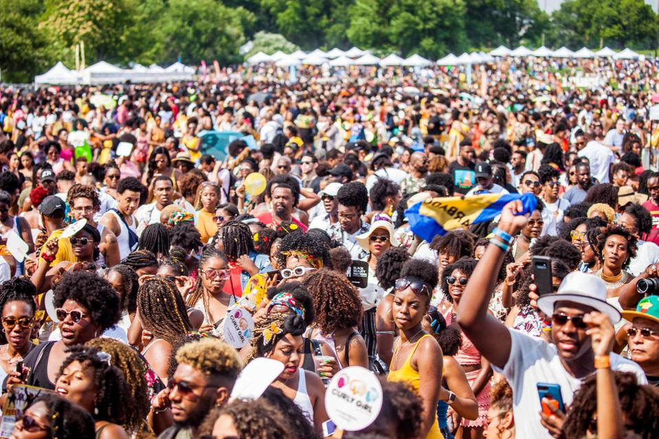 An image of the crowd at Curlfest festival in 2019