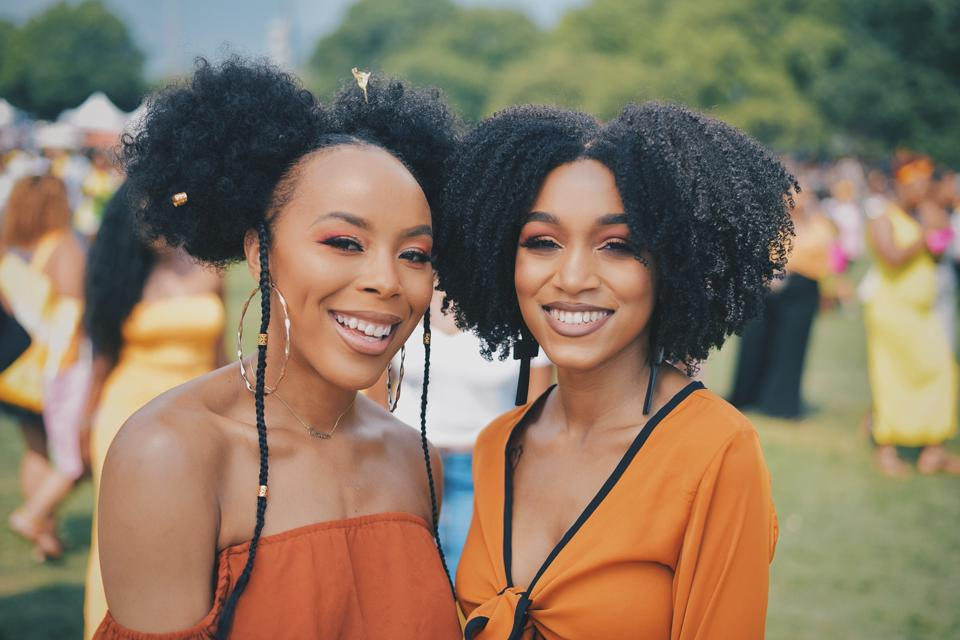 Two women dressed similarly at Curlfest festival in 2019
