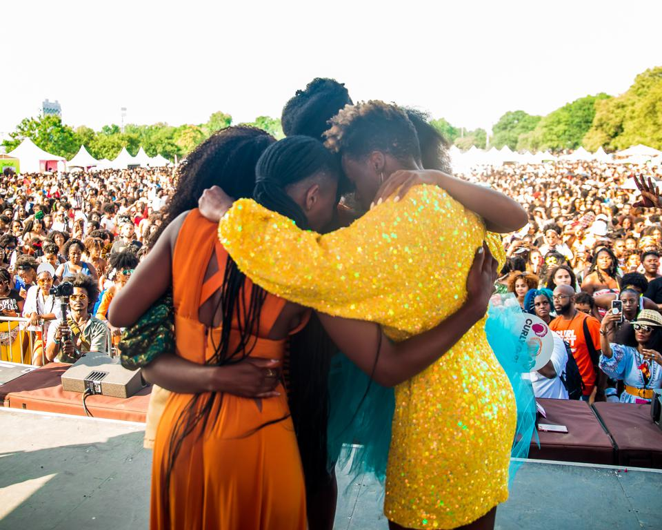 Curly Girl Collective co-founders gather in prayer at the Curlfest festival 2019