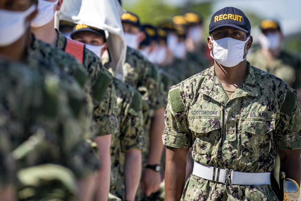 Navy recruits in formation wearing protective masks.