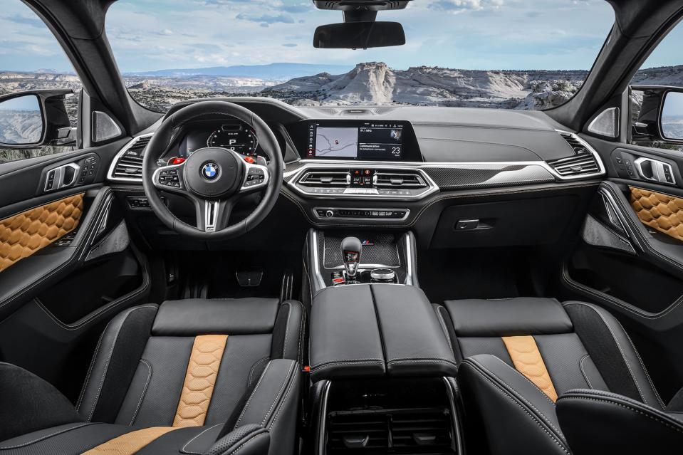 X6M interior delivers comfortable touches, but not enough to hide its inherent discomfort.