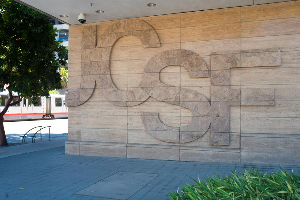 The University of California, San Francisco, 'UCSF' logo seen on a wall at the campus.