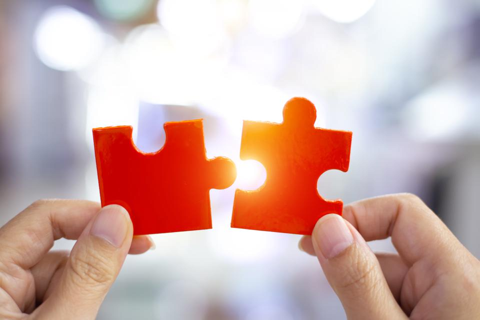 Success and strategy concept. Business woman hand connecting jigsaw puzzle.