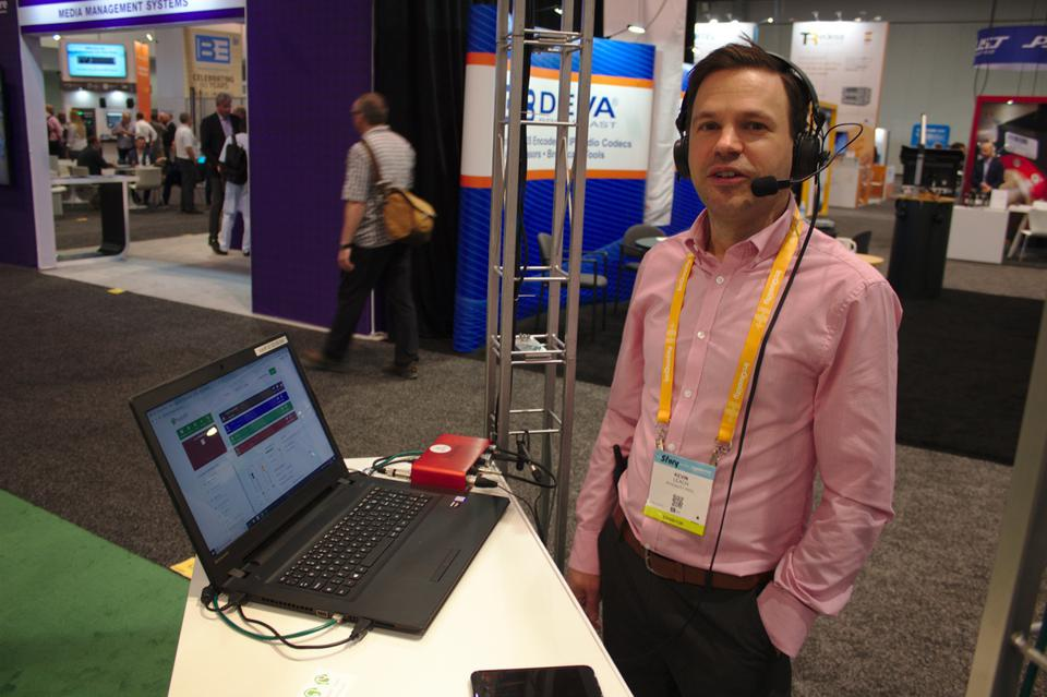 Kevin Leach at trade show wearing headset