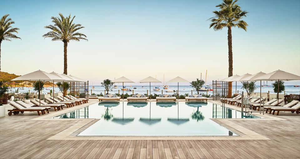 pool, palm trees, sunloungers