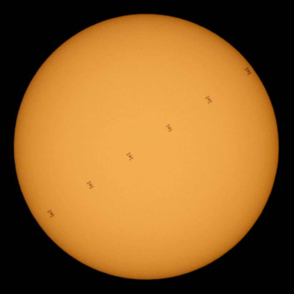 This composite image, made from six frames, shows the International Space Station in silhouette as it transits the Sun at roughly five miles per second, Wednesday, June 24, 2020.