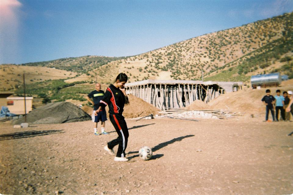 Goal Click image of a girl playing soccer in Iraqi Kurdistan in 2015.