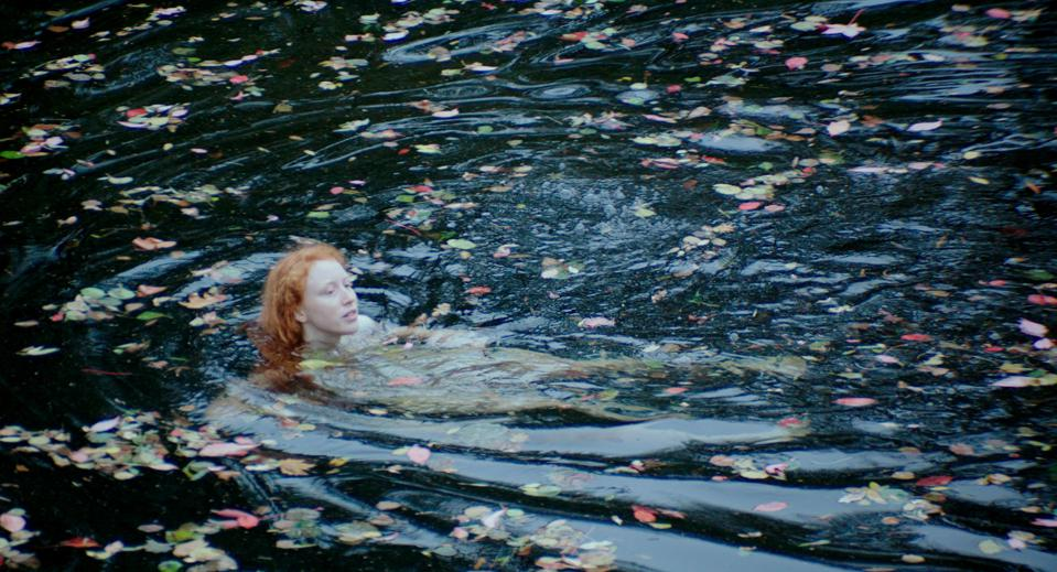 A woman bathing in a lake in 'The Portuguese Woman' (Photo credit: Basilisco Filmes/MUBI)