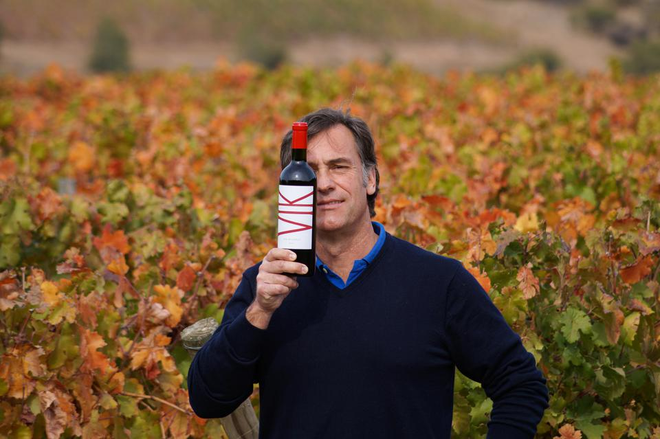 Winemaker Cristian Vallejo with a bottle of VIK.