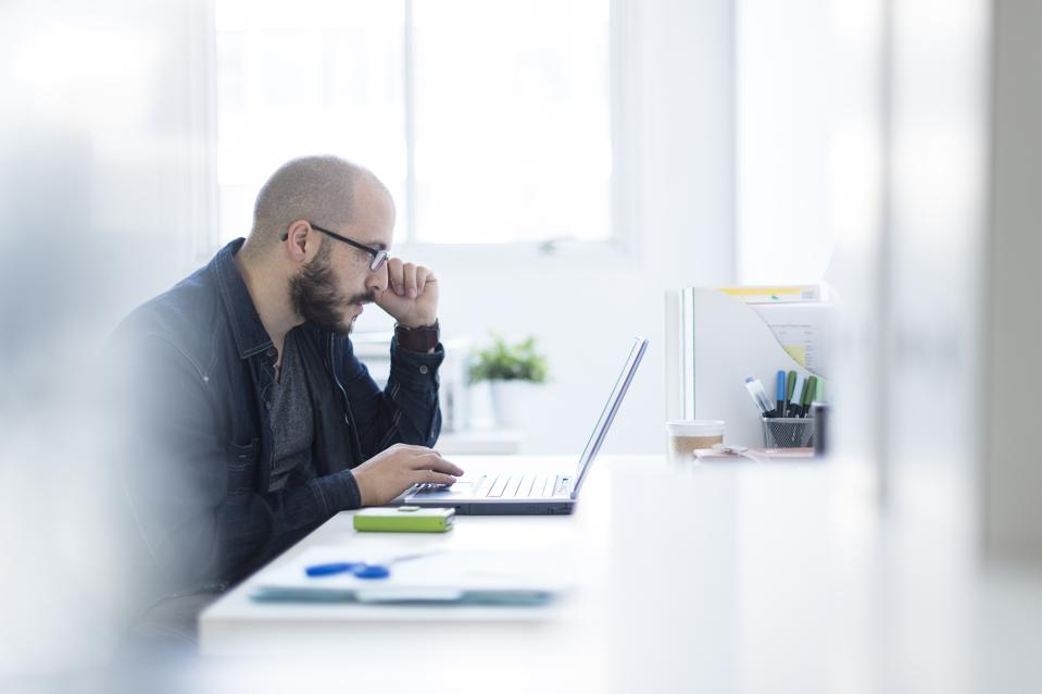 Hispanic businessman working at desk