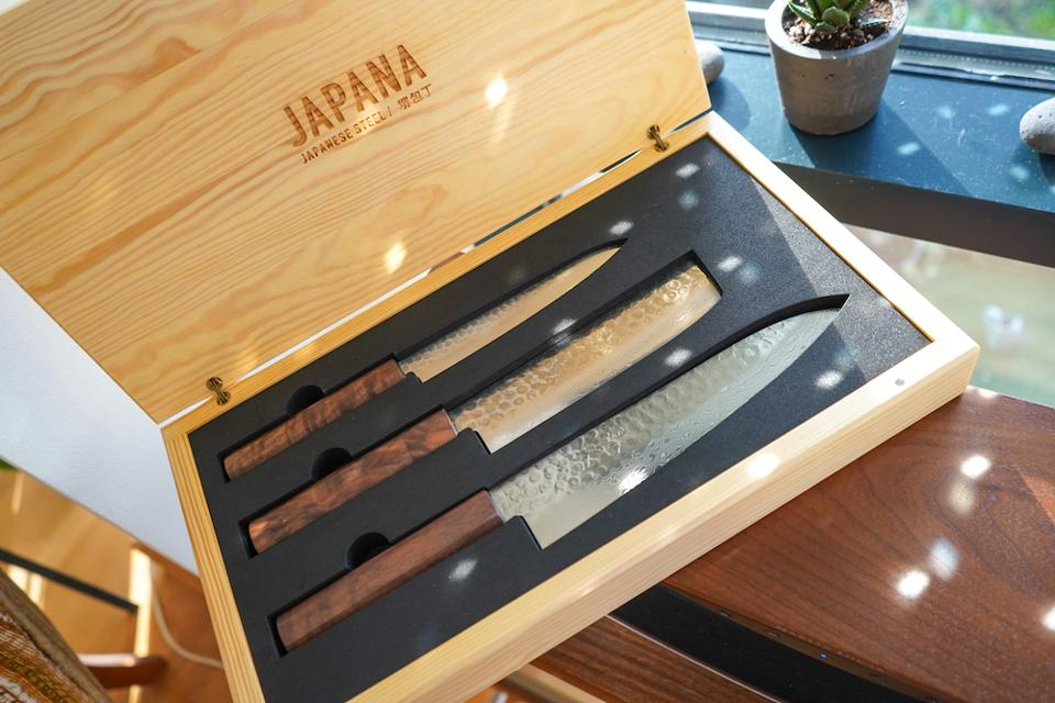 Sakai Kyuba knife set; a paring, vegetable and chef's knife presented in a decorative pine wood box.