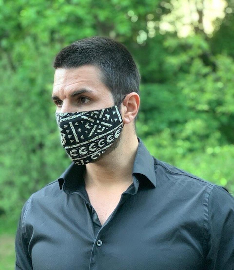Model Peter Antoniades wearing a Moyeva Mask, Eunice $25.00, made with 100% African cotton, Bemberg lining, and handcrafted in New York City.