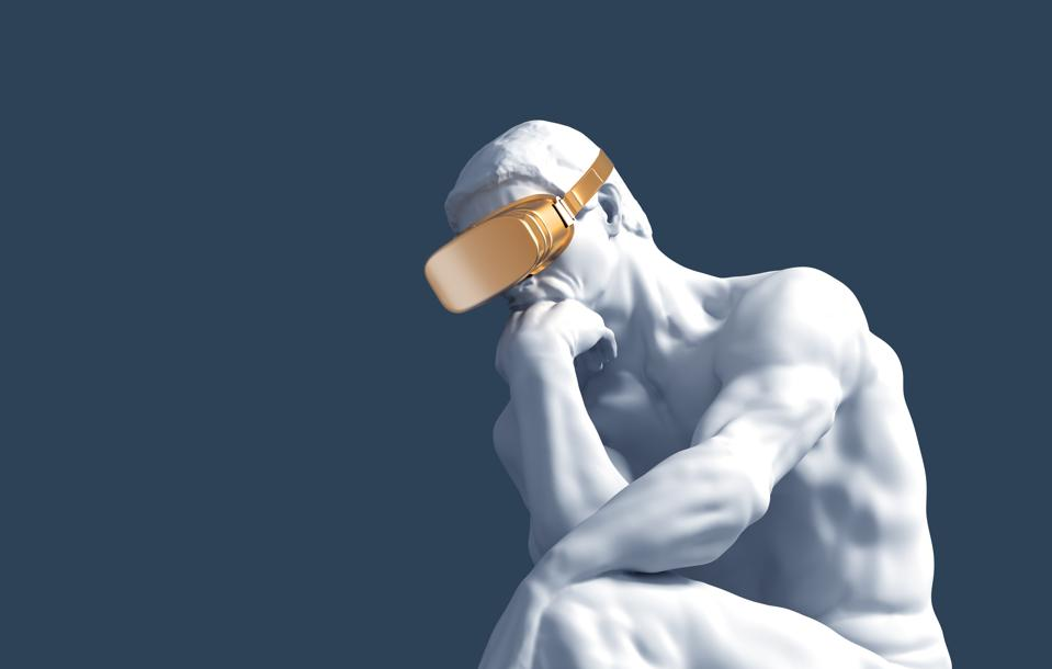 Thinker With Golden VR Glasses Over Blue Background