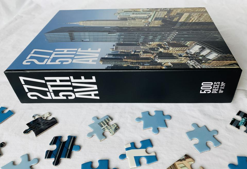 Puzzle pieces next to a box that reads 277 5th Ave.