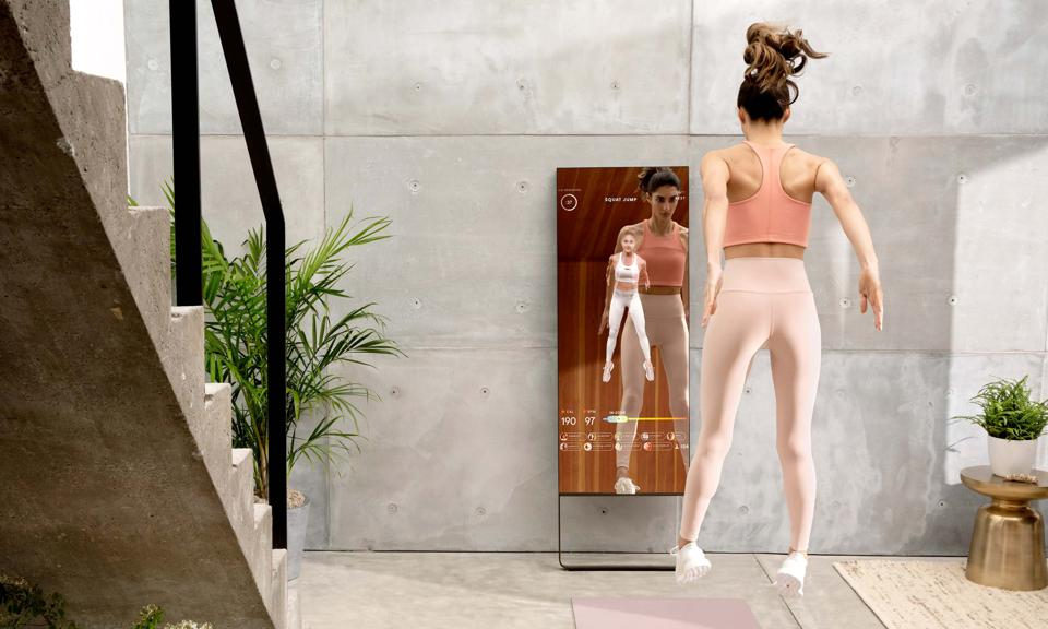 A promotional image of the Mirror workout mirror.