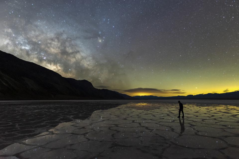 Milky Way reflections off the pools in Badwater Basin after a fresh rainfall in Death Valley.