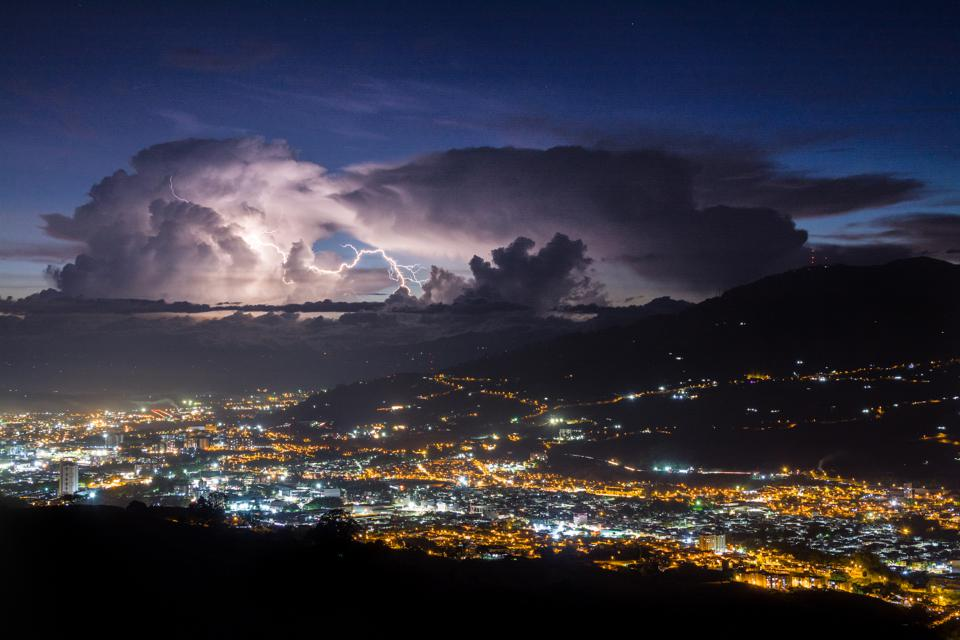 Lightning jumps between clouds above two Colombian cities.