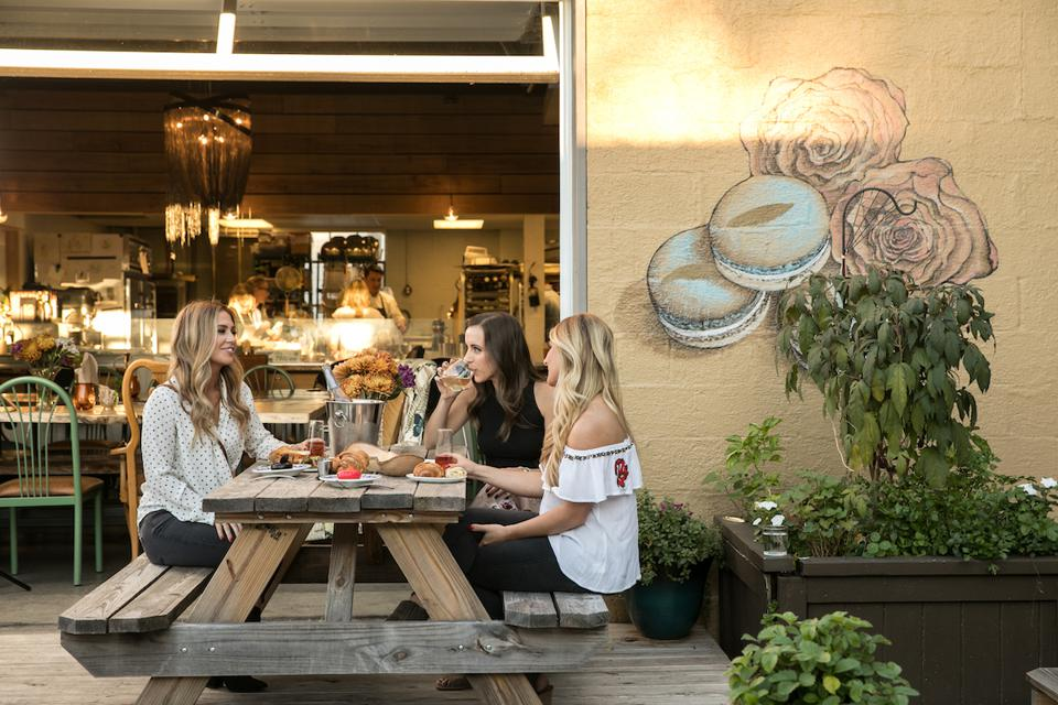 Women enjoying brunch outdoors at Gallery Pastry Shop in Indianapolis