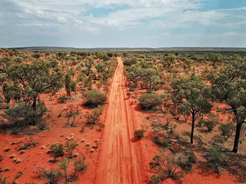 An Aerial shot of the red centre roads in the Australian Outback