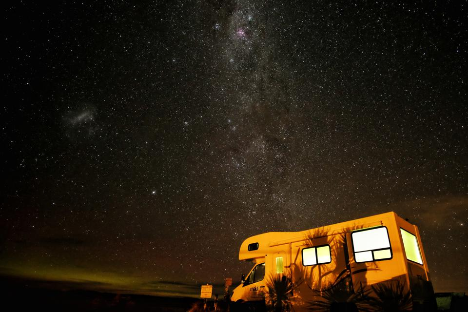 Travel is now isolationist - a camper van sits out under the stars