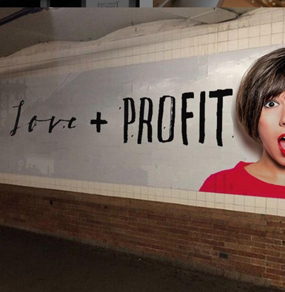 Subway poster ad with a woman's face (Pia Silva's) reading ″Love + Profit″