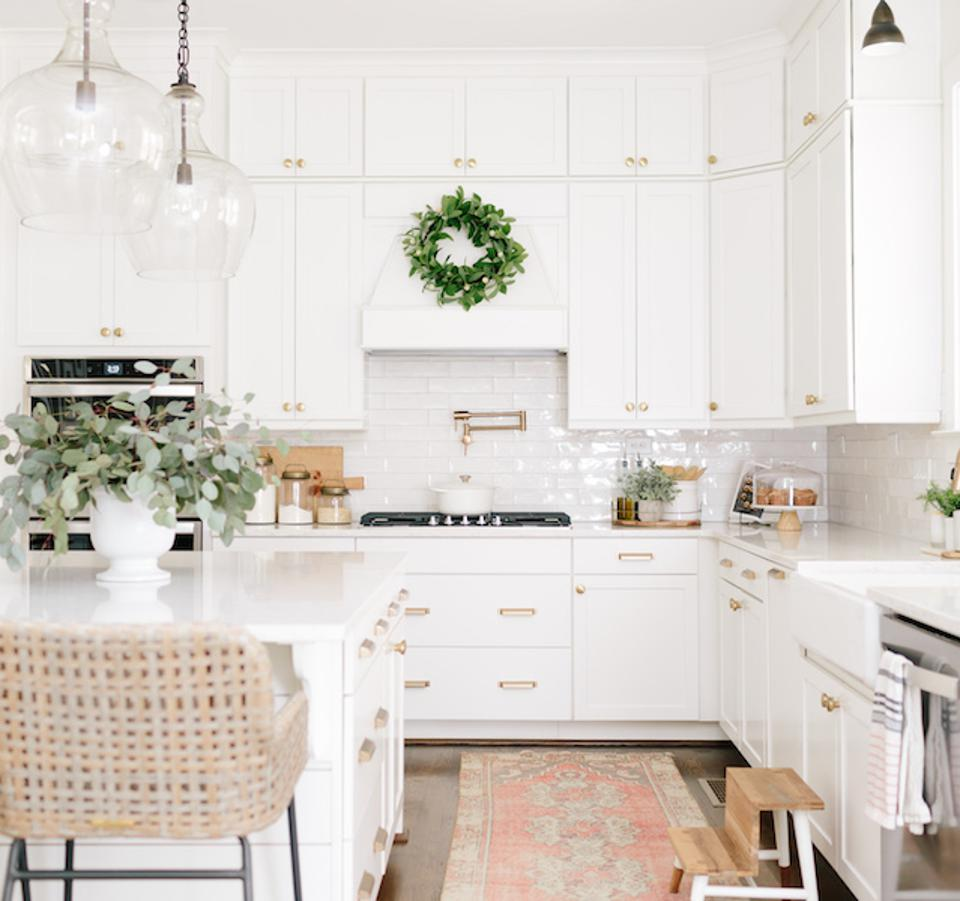 A kitchen with gold hardware