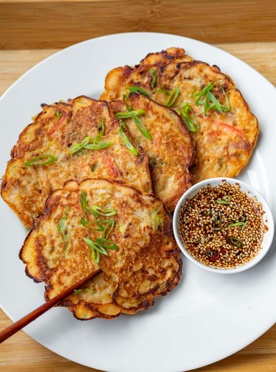 Christine Yi's homemade Bindaetteok, savory Korean pancakes on a plate. Cooking and Coping