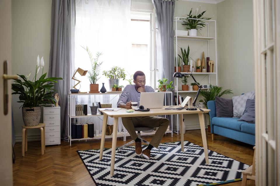 Man working on laptop at home office