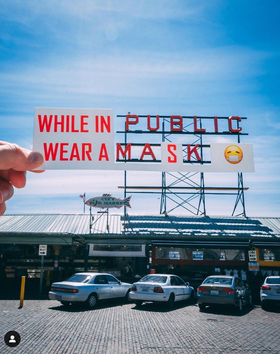 Pike Place Market sign ″While in Public Wear a Mask″