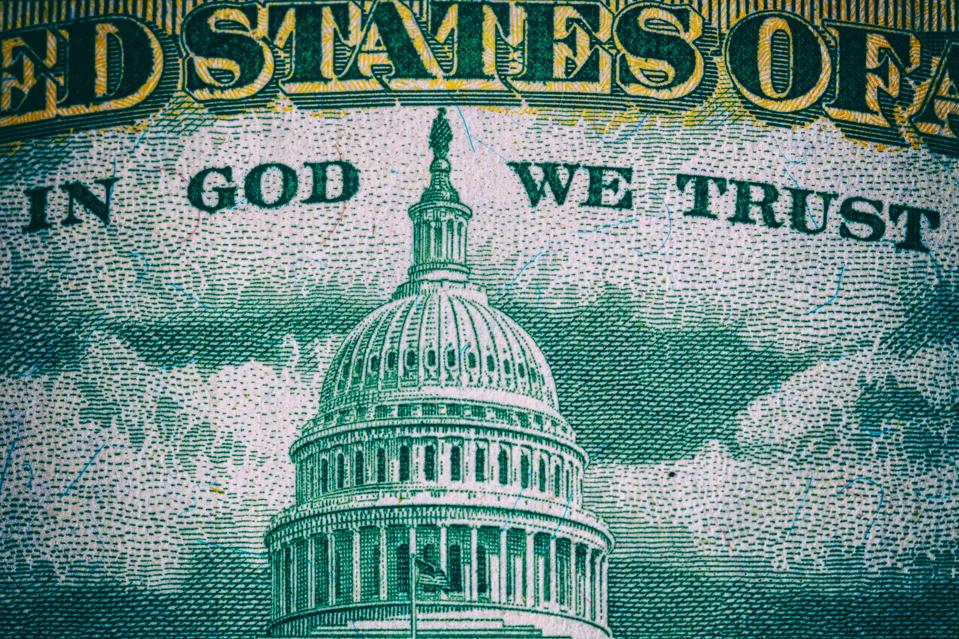 In God We Trust. Macro of a US dollar lettering in the back...
