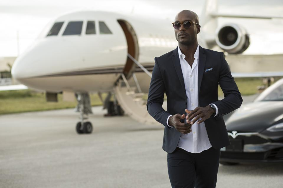 A business traveller steps off a private jet chartered by Victor jets