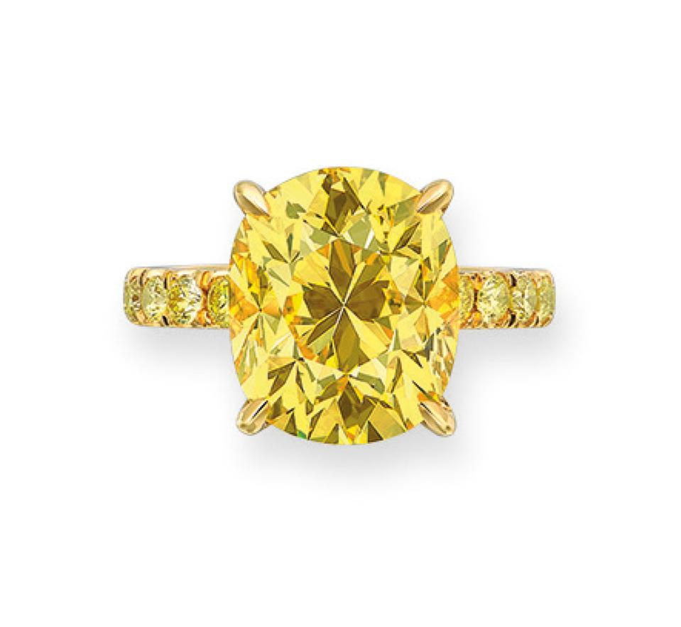 Gold ring with a 7.03-carat fancy vivid yellow diamond. Estimate: $388,732 - $647,886