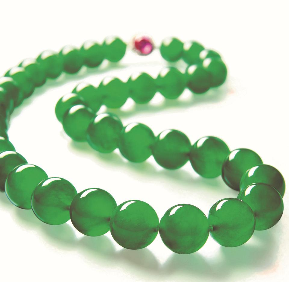 An Imperial Jade necklace composed of 37 jadeite beads originating from the same rough.