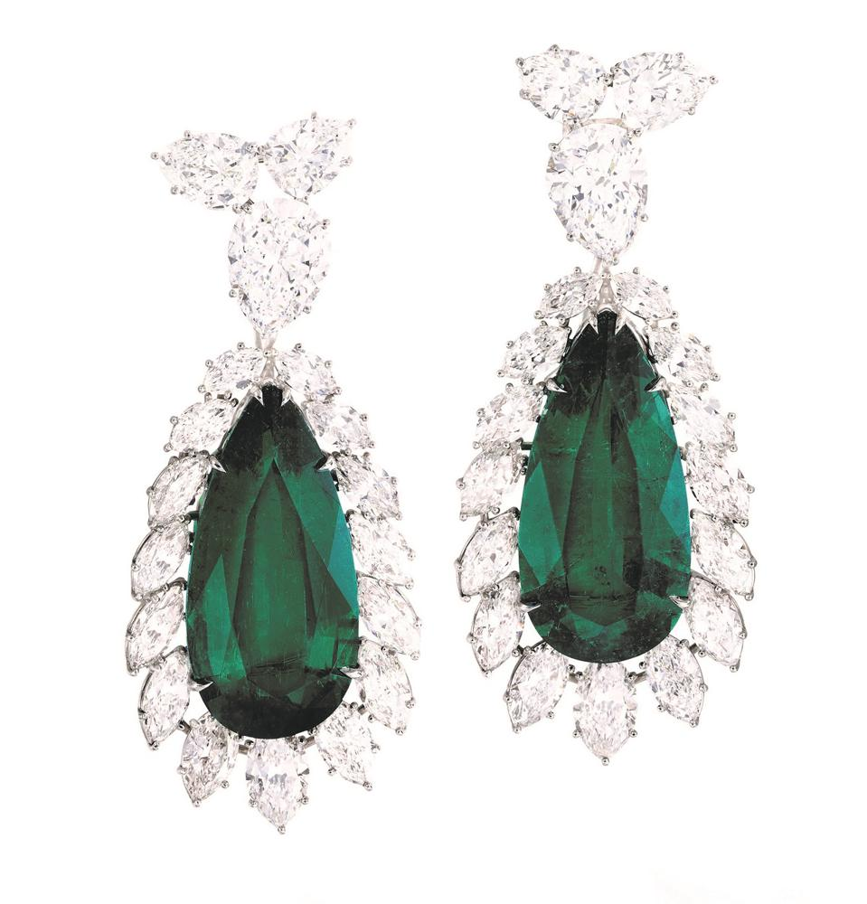 Harry Winston emerald and diamond earrings. Its estimate is $1.6 million - $1.9 million