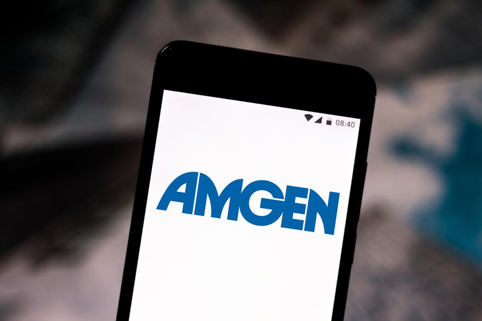In this photo illustration an Amgen logo seen displayed on a...