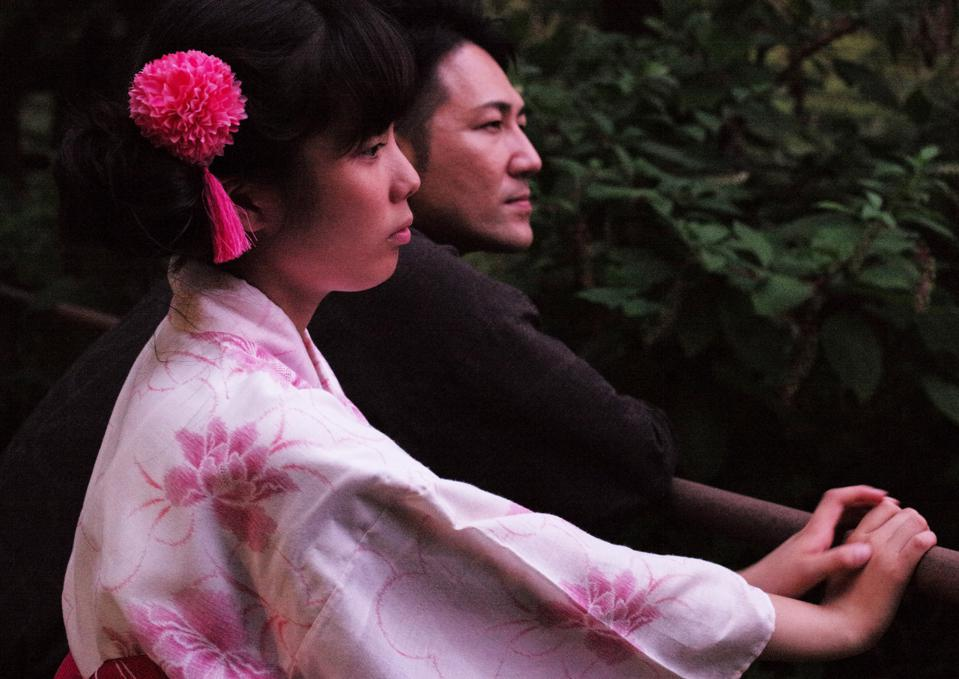 Yuichi Ishii and Mahiro wearing a traditional Japanese pink outfit in Herzog's new film