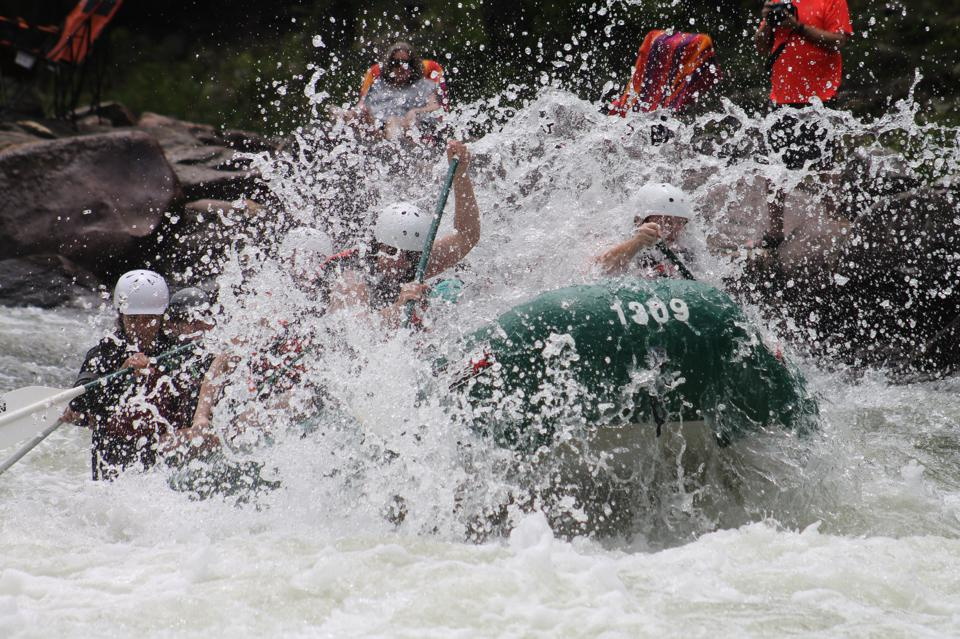 Team rafting on a whitewater river